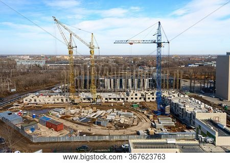 House Construction. Top View Of The Construction Site. Photos Of High-rise Construction Cranes And A