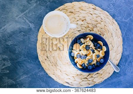 Morning, Breakfast Time, Cereal Mini Pancake, Mini Pancakes In A Dark Blue Bowl With Maple Sirup Hon