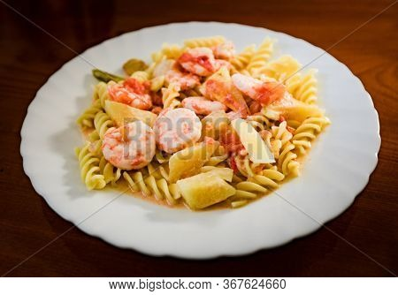 Seafood pasta in sweet and sour sauce. Asian style
