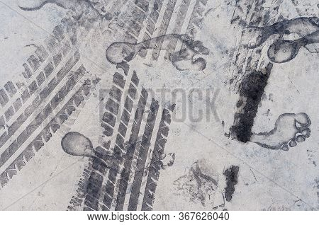 Road Tire And The Human Footprint On The Road. Background Texture, Pattern. The Texture Of The Tire