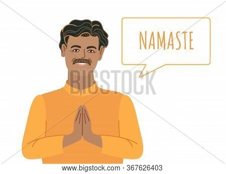 Man Making Namaste. An Indian Man In Traditional Clothes Making Gesture With Hands, Smiling, And Say