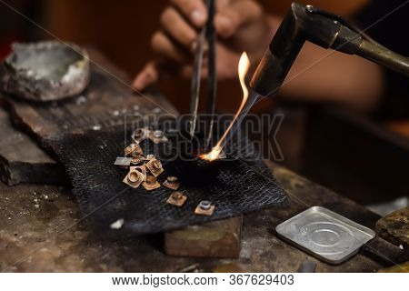 A Person Is Melting Silver To Make Jewellery. Craftsman At Work