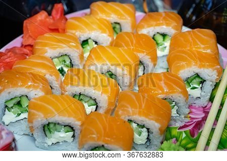 Sushi With Red Fish. Sushi Plate, Wasabi And Sushi Sticks