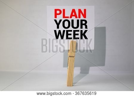Advice To Plan Your Week In Red Text On A Yellow Sticky Note Posted On The Page Of A Calendar As A R