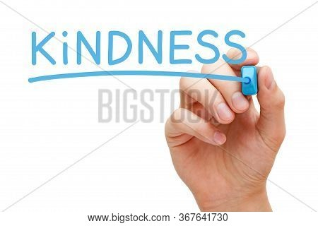 Hand Writing The Word Kindness With Blue Marker On Transparent Wipe Board Isolated On White Backgrou