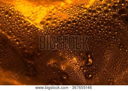 Abstract Orange Background. Drops Of Water On The Surface Are Illuminated By The Setting Sun.