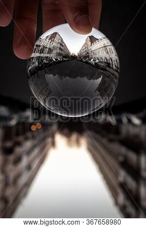 Reflection Of A Long Street And Buildings In A Lens Ball. Abstract, Artsy, Atypical Concepts
