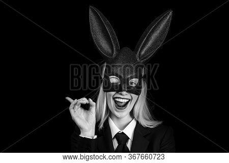 Portrait Of A Happy Woman In Bunny Ears Winking. Young Girl Easter Woman In Bunny Ears. Sweet Lovely