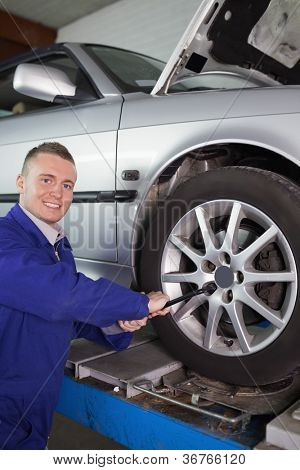 Mechanic using a wrench in a garage