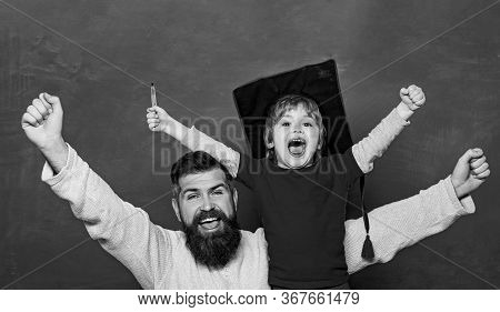 Hooray. Daddy And Son Raising Clenched Fists In Hooray Gesture. Father Teaching Her Son In Classroom