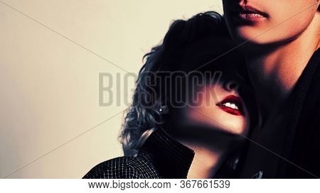 Affectionate Couple Having A Fun While A Photo Session. Young Heterosexual Couple Embracing. Close U