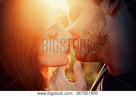 Beautiful Couple Is Kissing. Valentines Couple In Love. Romance At Night For Valentines Day Concept.