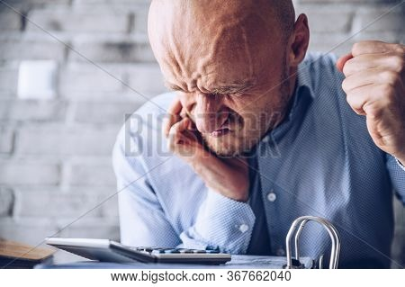 Financial Or Health Problem, Stressed Man In The Office