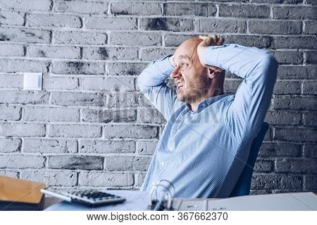 Worried Confused Man In Shirt Working In The Office