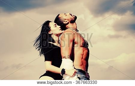 Sensual And Passion Concept For Sexy Couple. A Passion For Latin Man Body. Sensual Couple On Sky Bac