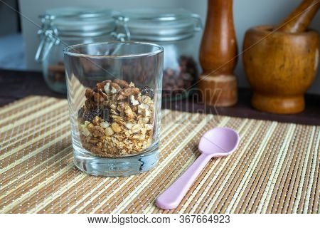 Healthy Lifestyle. Healthy And Nutritious Muesli In A Glass. For Breakfast, Natural Muesli With Nuts