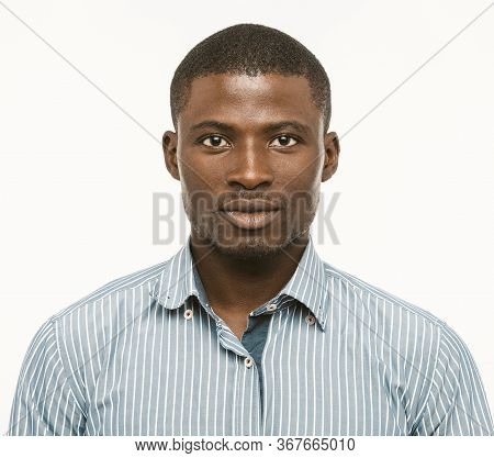 Attractive Dark-skinned Guy Looks Confident. African American Serious Man Isolated On White Backgrou