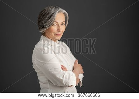 Pretty White-haired Woman Smiles Looking At Camera With Arms Crossed. Stylish Caucasian Businesswoma