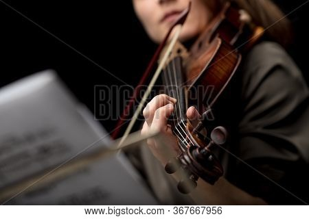 Woman Violinist Playing A Classical Baroque Violin