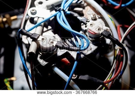 Wires Close-up In Household Home Appliance Coffee Maker. The Concept Of Home Appliances Repair