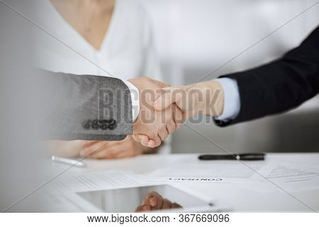 Business People Shaking Hands Finishing Contract Signing, Close-up. Business Communication Concept.