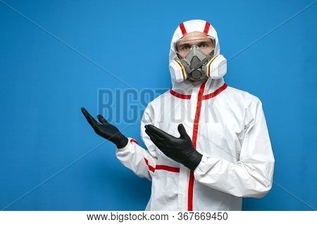 Epidemiologist In A Chemical Protective Suit Shows Copyspace On A Isolated Background, Man, Biologis
