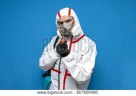 Man In A Chemical Protective Suit Holds A Spray Bottle On A Isolated Background, Epidemiologist, Bio