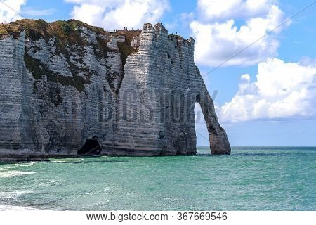 Etretat, France - September 1, 2019: This Is The Cliff D\'aval With The Manneport Arch On The Coast,