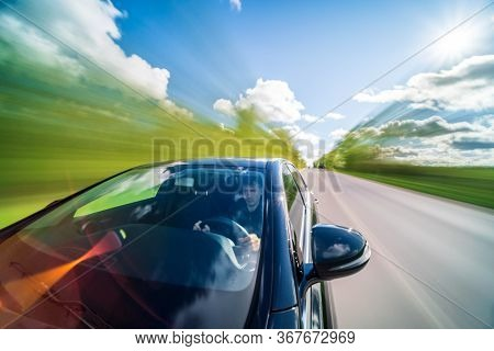 Driver Point Of View In Cars Windshield On Countryside. Long Exposure Blur Shoot