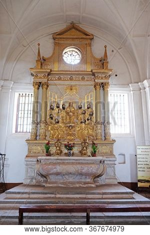 OLD GOA, INDIA - FEBRUARY 18, 2020: Descent of the Holy Spirit, Pentecost, altar in the Se cathedral dedicated to Catherine of Alexandria, Old Goa, Goa, India