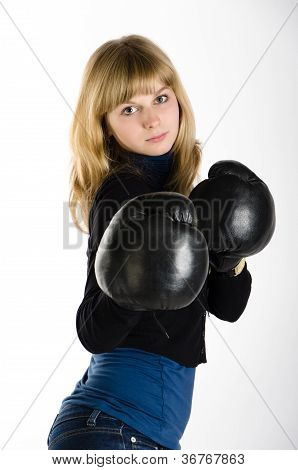 Girl in boxing gloves on white background