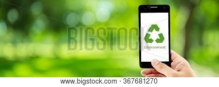 Smart Phone Holding Hand With Recycle Symbol Eco Environment Icon Concept With Green Bokeh Backgroun