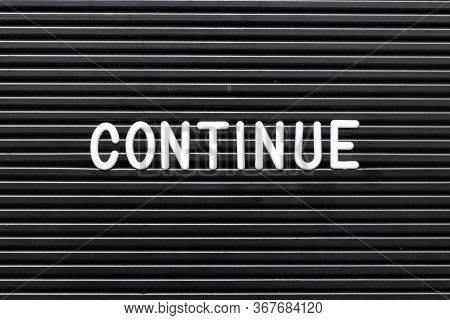 Black Felt Board With White Alphabet In Word Continue Background