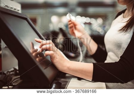 Young Woman Hand Doing Process Payment On A Touchscreen Cash Register, Pos, Finance Concept