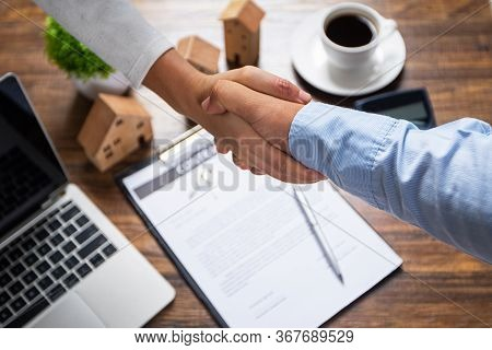 Successful Agreement , Estate,home Buying Contract Concept, Buyer Shaking Hand With Bank Gent After