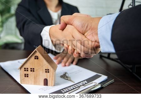 Real Estate, Handshake And Sign Contract Concept, Seller And Buyer Of Home Successful Negotiate And