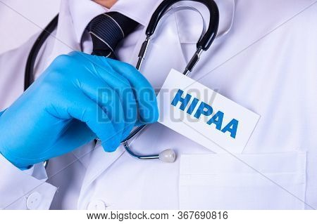 Doctor, Man Put A Card With The Text Hippa, The Health Insurance Portability And Accountability Act