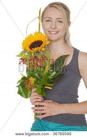woman with sunflower bouquet