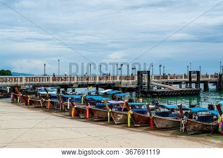 Parking Of Tieded Traditional Thai Longtail Boats With Colorful Tape, Thailand. Waiting For Passenge