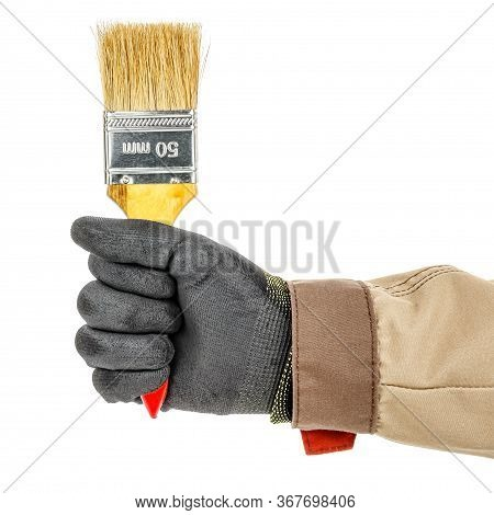 Worker Hand In Black Protective Glove And Brown Uniform With Unused Construction Paintbrush Close-up