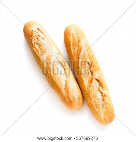 Fresh Baguette Bread Isolated On White Background. Homemade French Two Baguette Loafs, Top View, Cop
