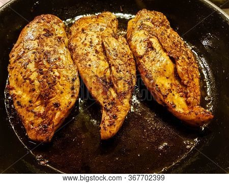 Filled And Marinated Chicken Breasts In A Frying Pan