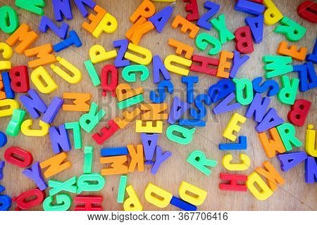 Alphabet Learning Concept: Close Up Of Toy Letters In The Kindergarten