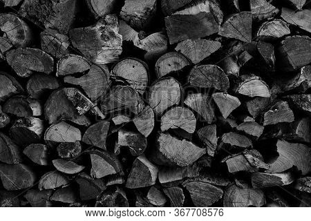 Dry Chopped Firewood Logs Ready For Winter As Background Or Texture