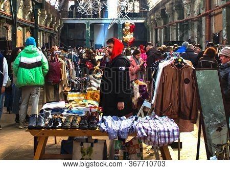 Lviv, Ukraine - February 16, 2020 : People Shopping On Garage Sale In Lem Station, Tlum And Cram. Hi