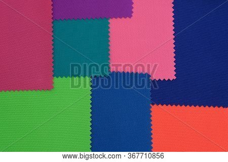 Samples Of Fabrics In Different Colors. Blue, Green, Pink Piece Of Fabric With Texture. Lightweight