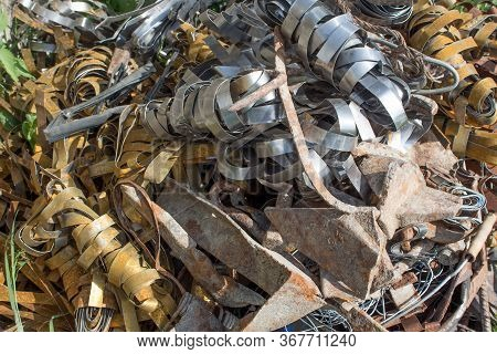 Pile Scrap Metal Shavings Isolated On White Background. Scrap Metal On Recycling Plant Site