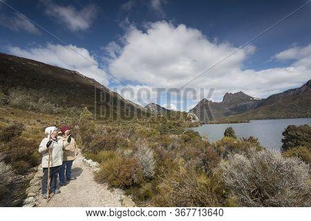 Senior Woman Walking In National Park In Tasmania.