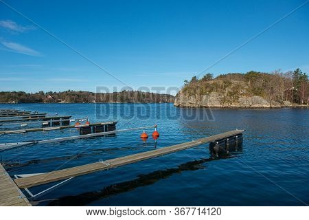 Empty Floating Docks In The Spring Sun.
