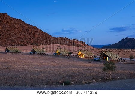 Evening At Small Chalets Of A Desert Lodge Near The Namib-naukluft National Park Close To Sossusvlei